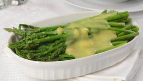Asparagus and Hollandaise sauce stock video footage
