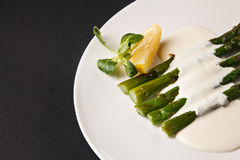 Asparagus with lemon Stock Photo