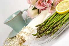 Asparagus with lemon table setting Stock Images
