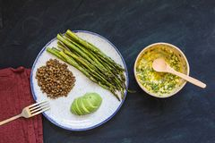 Asparagus with lentils and avocado stock photo