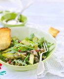 Asparagus , mushroom and ruccola warm salad Royalty Free Stock Photos