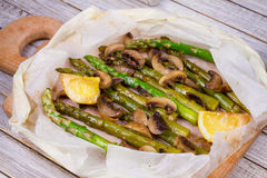 Asparagus and Mushrooms in Parchment. Stock Photos