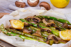 Asparagus and Mushrooms in Parchment. Royalty Free Stock Images