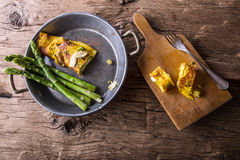 Asparagus and omelette.Omelette stuffed with asparagus  and cheese for a breakfast Stock Images