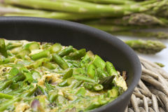 Asparagus omelette in a pan close-up Royalty Free Stock Images