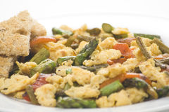 Asparagus omelette red pepper and slices of bread Stock Photography