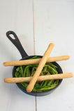 Asparagus in a pan with bread sticks Stock Image