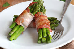 Asparagus and pancetta wraps Royalty Free Stock Image