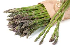 Asparagus in paper bag isolated on white Royalty Free Stock Photos