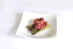 Asparagus and Parma Ham. Lunch on a plate - asparagus tips and Parma ham stock photos
