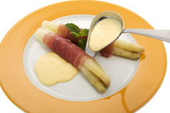 Asparagus with parma hams and sauce Hollondaise Stock Photos