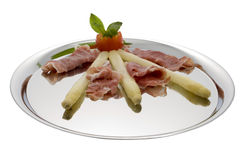 Asparagus with parma hams on silver tray Royalty Free Stock Images