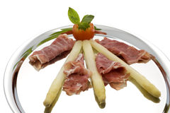 Asparagus with parma hams on silver tray Stock Photo