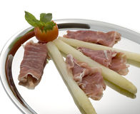 Asparagus with parma hams on silver tray Royalty Free Stock Image