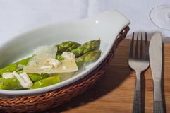 Asparagus with parmesan cheese. Bleached asparagus ready to eat royalty free stock images