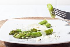 Asparagus with parmesan cheese. A group of asparagus bleached with parmesan cheese top royalty free stock photos