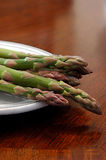 Asparagus on plate. Still life with asparagus stock image