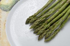 Asparagus in a Plate with Water Droplets royalty free stock image