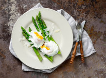 Asparagus with poached eggs Stock Image