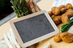Asparagus, potatoes, empty blackboard Stock Photo