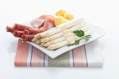 Asparagus,potatoes,parma ham and parsley Stock Photo
