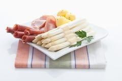 Asparagus,potatoes,parma ham and parsley Stock Photo