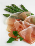 Asparagus and prosciutto royalty free stock photography