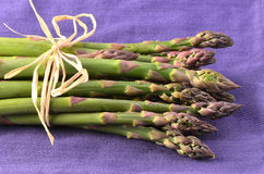 Asparagus on purple napkin Royalty Free Stock Image