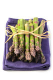 Asparagus on purple napkin Royalty Free Stock Photos
