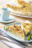 Asparagus quiche. Delicious aspargus homemade quiche on a blue dish Stock Images
