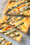 Asparagus quiche with pecorino and bacon Royalty Free Stock Images