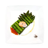 Asparagus with red caviar and egg Royalty Free Stock Images