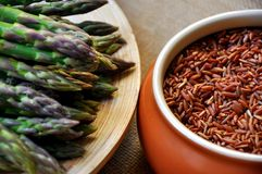 Asparagus and red rice Stock Photo