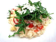 White Asparagus Risotto. A bowl of creamy white asparagus risotto, served with cherry tomatoes and arugula. Topped with Parmesan cheese Stock Image