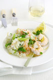 Asparagus risotto with shrimp. And lemon paired with a skewer of grilled shrimp and a lemon wedge Royalty Free Stock Photography