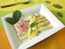 Asparagus with sage hollandaise sauce and ham Stock Photo
