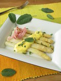 Asparagus with sage hollandaise sauce and ham Royalty Free Stock Images