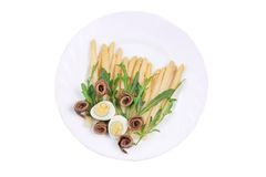 Asparagus salad with anchovies. Royalty Free Stock Photos