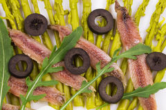 Asparagus salad with anchovies. Stock Images