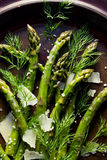 Asparagus salad with cheese and fresh dill on a plate Stock Photo