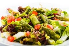 Asparagus salad. Fresh asparagus salad with tomatoes Royalty Free Stock Photography