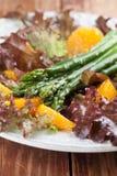 Asparagus salad with oranges and hemp seeds Stock Photos