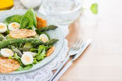 Asparagus Salad with quails eggs and cheese crisps. Asparagus Salad with quails eggs, avocado and cheese crisps, healthy detox lunch Stock Photos
