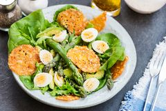 Asparagus Salad with quails eggs and cheese crisps. Asparagus Salad with quails eggs, avocado and cheese crisps, healthy detox lunch Stock Images