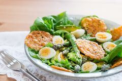 Asparagus Salad with quails eggs and cheese crisps. Asparagus Salad with quails eggs, avocado and cheese crisps, healthy detox lunch Royalty Free Stock Photography
