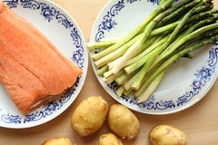 Asparagus and salmon on table Royalty Free Stock Photo