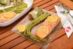 Asparagus with salmon. Tasty dish with Asparagus,artichoke and salmon Royalty Free Stock Photography