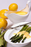 Asparagus with sauce Stock Images