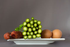 Asparagus, sausage and eggs on a plate Royalty Free Stock Image
