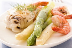 Asparagus with seafood Stock Images